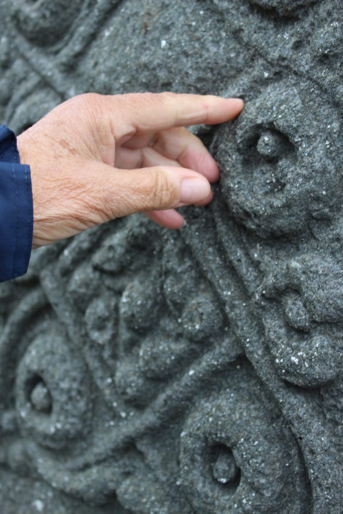 Touching the St John's Cross, Iona (c) Sally Foster, hand of Jonquil Alpe, her mother