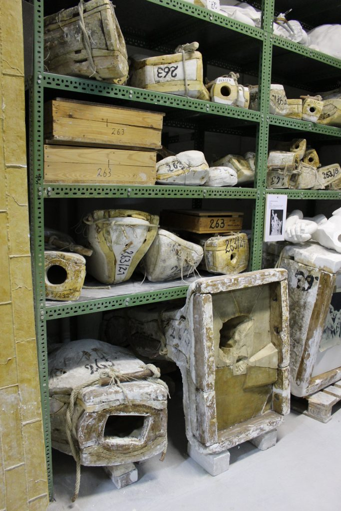 Shelving in a plaster-cast manufacturing workshop in Berlin, stacked with piece moulds (c) Sally Foster