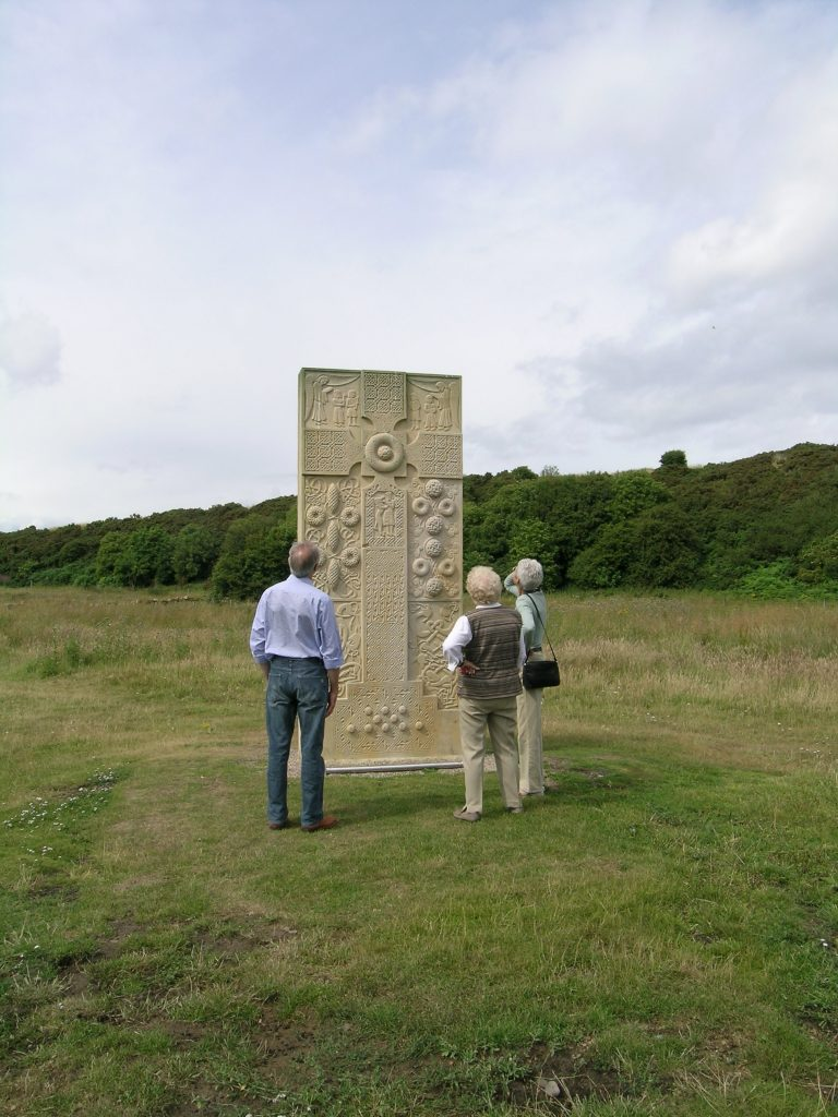 Visitors look at the modern recreation of the Pictish Hilton of Cadboll cross-slab. (c) Sian Jones