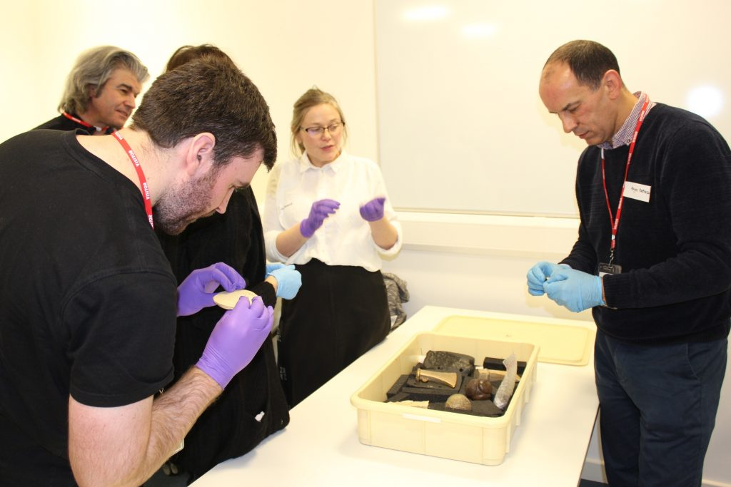 Some of the attendees at 28 November 2019 workshop held in National Museums Scotland, shown replicas of archaeological objects by Senior Curator Dr Alice Blackwell (c) Sally Foster